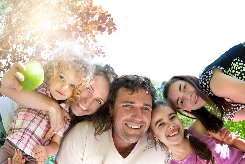 family of 5 outdoors around camera